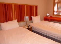M Hotel bedroom 250x179